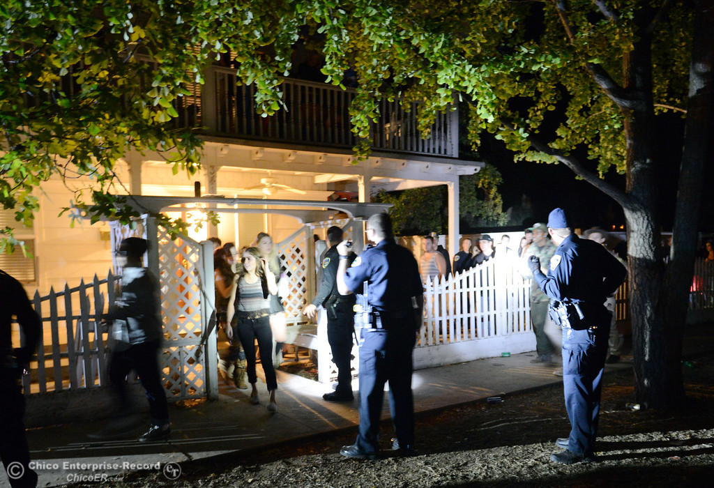 Description of . Chico Police responded an anonymous call about two large parties of up to 1000 people next to each other along W. 9th St and Normal Ave Friday, November 1, 2013 in Chico, Calif. People were jumping from the second story before police came and broke up the party.  (Jason Halley/Chico Enterprise-Record)