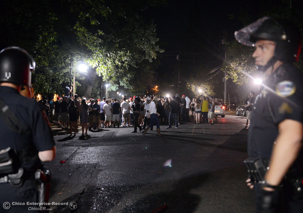Description of . People gather at W. 6th St and Ivy St. and Chico Police responded to large incidents in the south campus area Friday, August 23, 2013 in Chico, Calif. 
