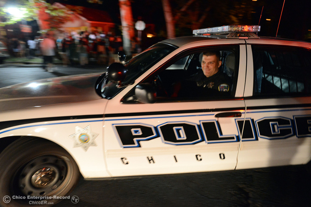 Description of . Chico Police officer Tony Ferreira (left) responded to large incidents in the south campus area Friday, August 23, 2013 in Chico, Calif. 