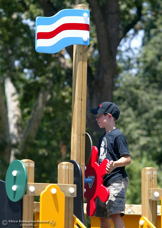 . Tyler Stearns, 9, plays on the ship as kids play at the Nico Cardoza Memorial Park which is now open in Caper Acres in this file photo from July 2007. (Jason Halley/Chico Enterprise-Record)