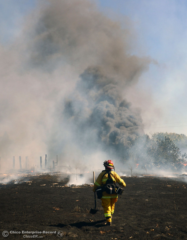 Description of . Cal Fire - Butte County Capt. Lydia Soileau with Oroville Fire and El Medio Fire and battle a fire along Power House Hill Rd and Dad Lane that burned several structures and debris piles Thursday, September 26, 2013, in Oroville, Calif.  (Jason Halley/Chico Enterprise-Record)