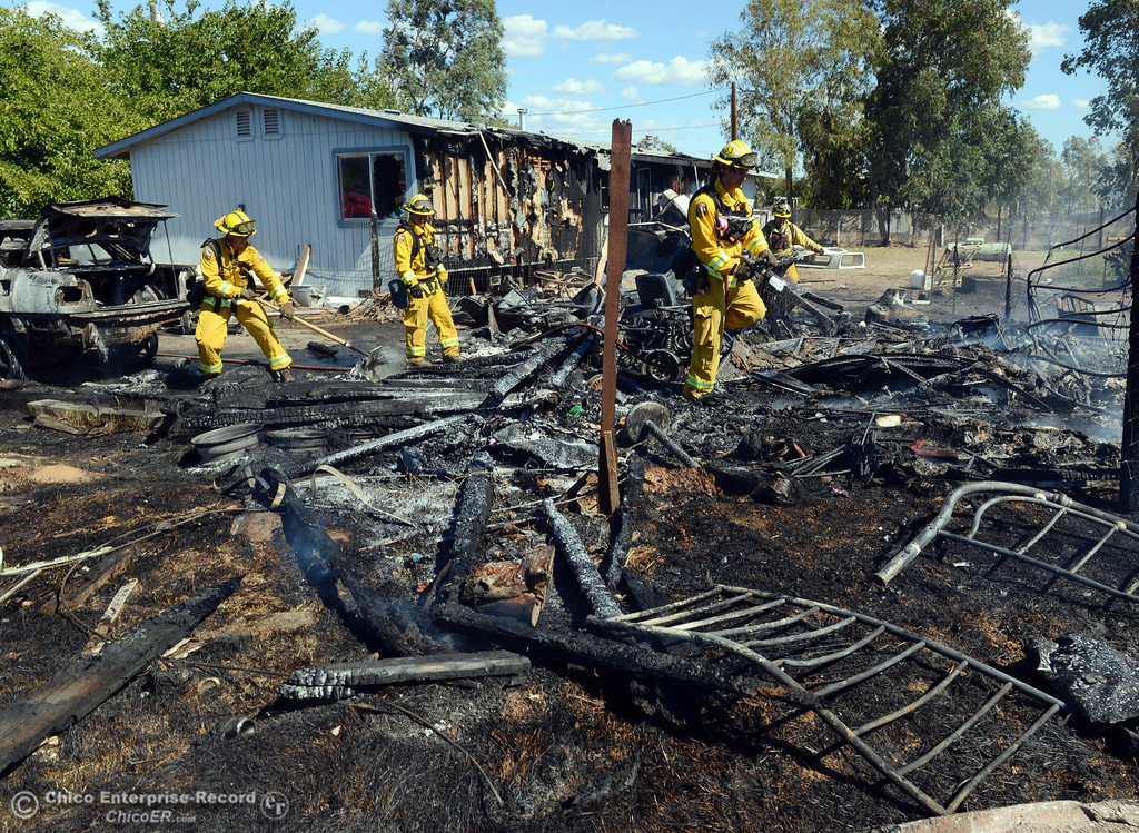 Description of . Oroville Fire, El Medio Fire, and Cal Fire - Butte County battle a fire along Power House Hill Rd and Dad Lane that burned several structures and debris piles Thursday, September 26, 2013, in Oroville, Calif.  (Jason Halley/Chico Enterprise-Record)