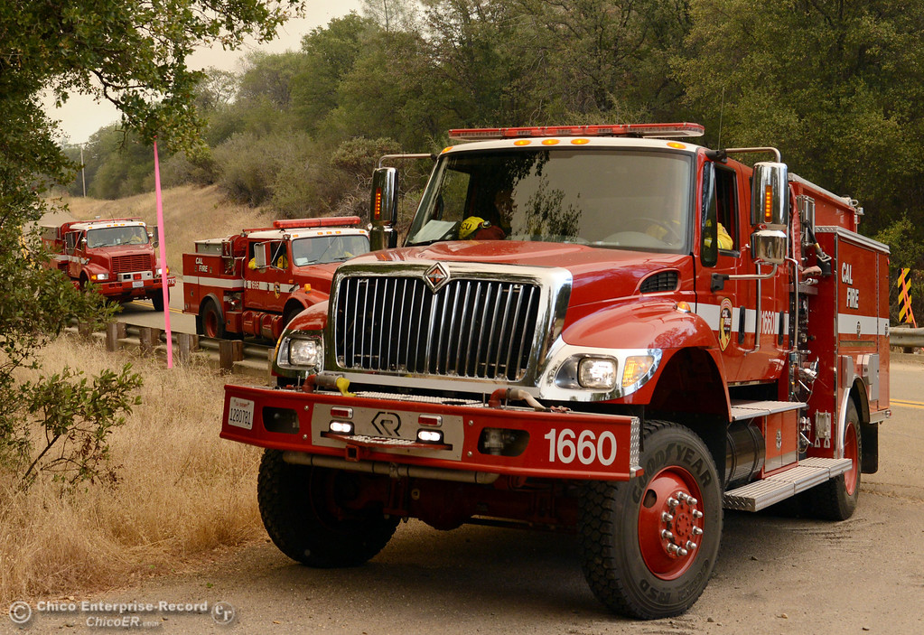 Description of . Cal Fire engines stage at Jerrigan Way and Hurleton Swedes Flat Road as mandatory evacuation areas around the Swedes Fire southeast of Oroville were expanded just after noon Saturday, August 17, 2013 in Oroville, Calif.  (Jason Halley/Chico Enterprise-Record)