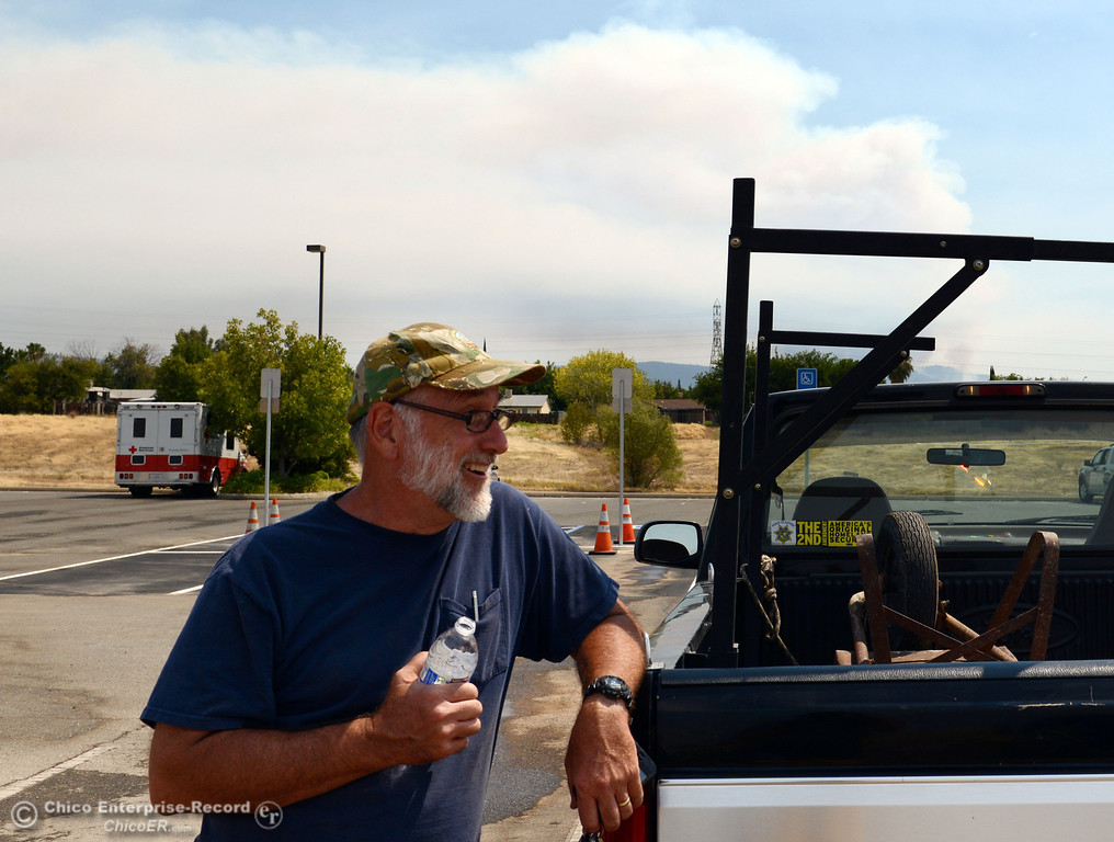 Description of . Pastor at Church of the Nazarene, Steve Holly helps set up the church area as a evacuation center as mandatory evacuation areas around the Swedes Fire southeast of Oroville were expanded just after noon Saturday, August 17, 2013 in Oroville, Calif.  (Jason Halley/Chico Enterprise-Record)