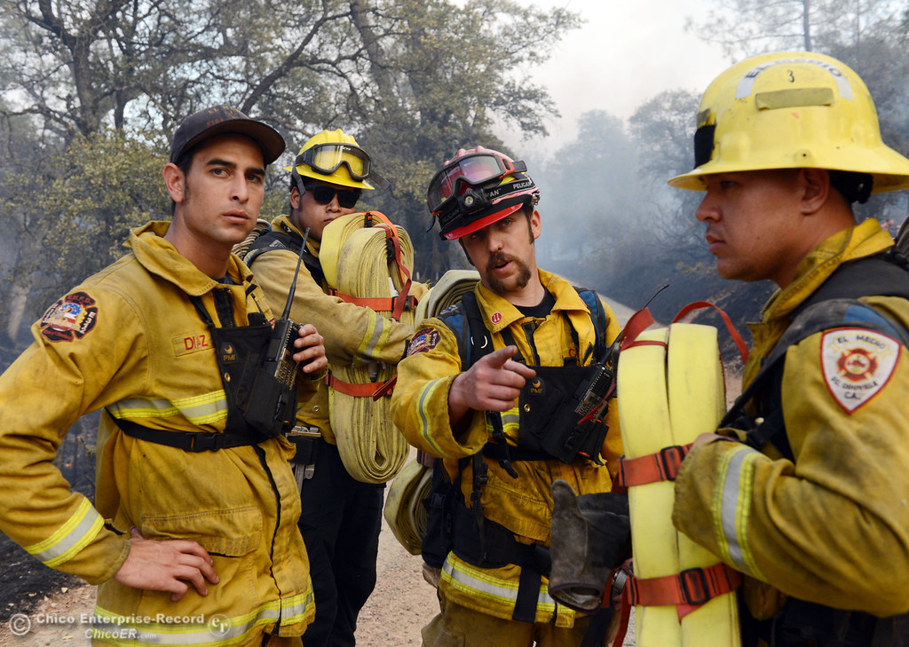 Description of . El Medio firefighters Cory Diaz, Brenden Perez, Capt. Donald Robinson, and Alex Otani (left to right) discuss their objective to battle the Swedes Fire that burned along Swedes Flat Road, in the vicinity of Chinese Wall Road, just east or Oro Bangor Highway Friday, August 16, 2013 in Oroville, Calif. Over 200 acres were burned with at least one structure lost. (Jason Halley/Chico Enterprise-Record)