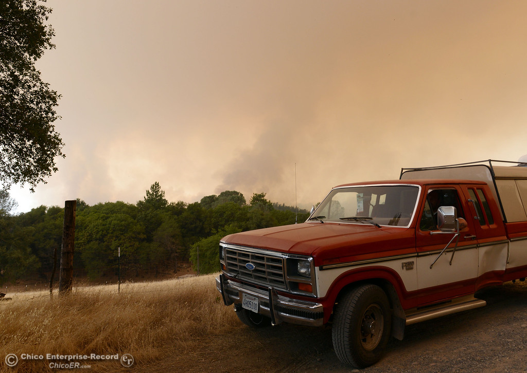 Description of . Residents leave the area of Hurleton Swedes Flat Rd. in the mandatory evacuation areas around the Swedes Fire southeast of Oroville that were expanded just after noon Saturday, August 17, 2013 in Oroville, Calif.  (Jason Halley/Chico Enterprise-Record)