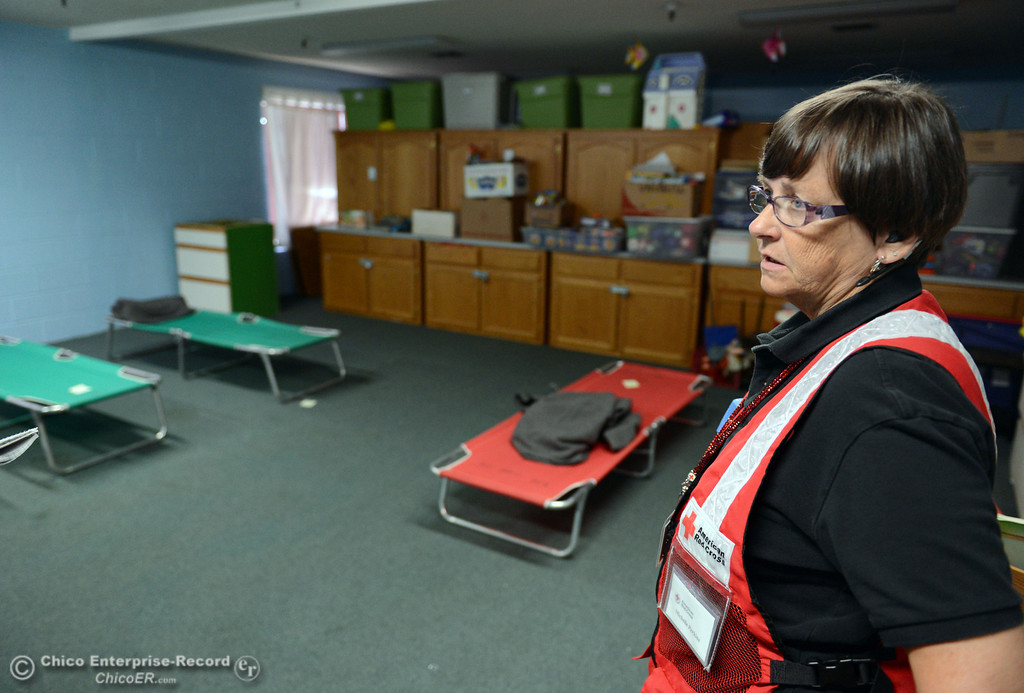 Description of . Red Cross Michelle Perkins talks about the availability they have at the Church of the Nazarene for mandatory evacuation areas around the Swedes Fire southeast of Oroville that were expanded just after noon Saturday, August 17, 2013 in Oroville, Calif.  (Jason Halley/Chico Enterprise-Record)