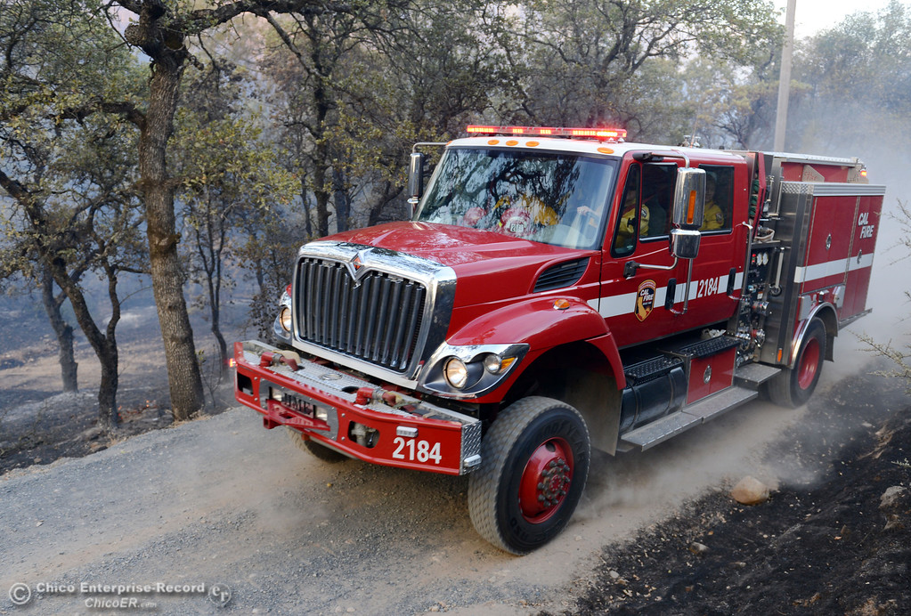 Description of . Cal Fire firefighters make their way along Chinese Wall Road toward the Swedes Fire that burned in the vicinity of Swedes Flat Road, just east or Oro Bangor Highway Friday, August 16, 2013 in Oroville, Calif. Over 200 acres were burned with at least one structure lost. (Jason Halley/Chico Enterprise-Record)
