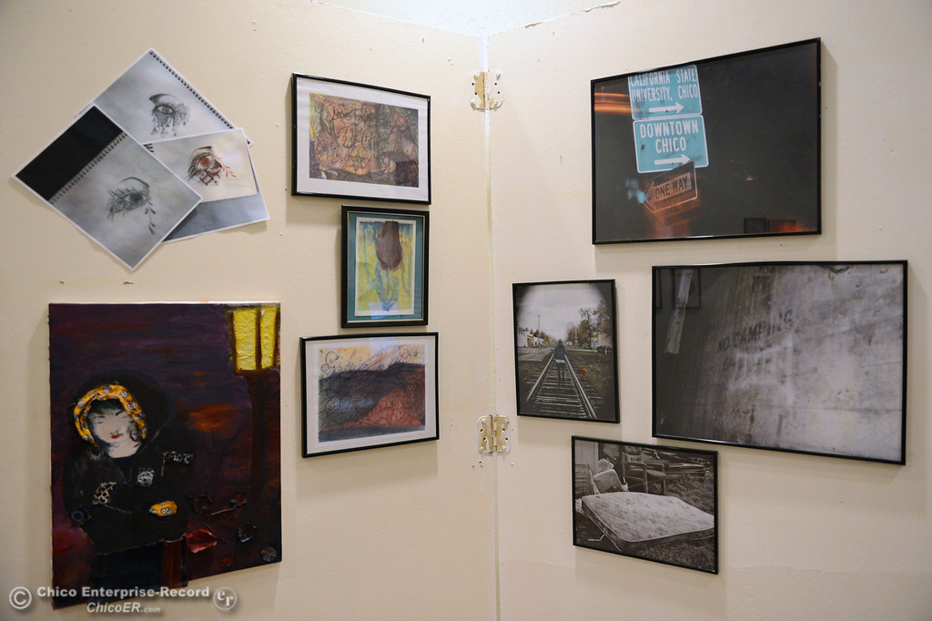 . Art is displayed on walls of The 6th Street Center for Youth, which hosted an open house, art show and poetry reading in recognition of Runaway and Homeless Youth Month Thursday, November 14, 2013 in Chico, Calif.  (Jason Halley/Chico Enterprise-Record)