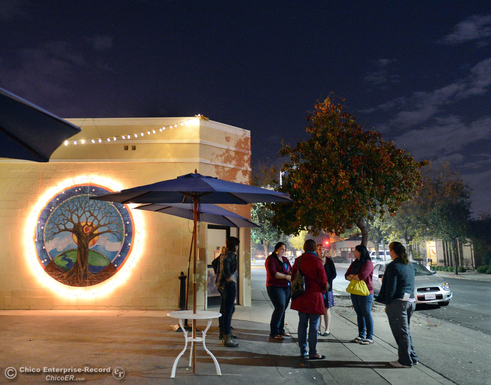 . People wait outside the 6th Street Center for Youth, which hosted an open house, art show and poetry reading in recognition of Runaway and Homeless Youth Month Thursday, November 14, 2013 in Chico, Calif.  (Jason Halley/Chico Enterprise-Record)