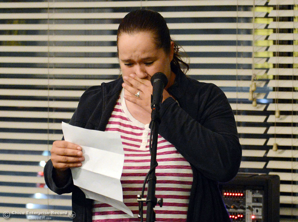 . Jessica DePriest, shares her story to people who came out for the 6th Street Center for Youth open house, art show and poetry reading in recognition of Runaway and Homeless Youth Month Thursday, November 14, 2013 in Chico, Calif.  (Jason Halley/Chico Enterprise-Record)