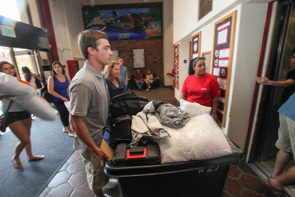 Description of . Ryan Mitchell, new resident of Whitney Hall, pushes a cart of his belongings into the elevator at Whitney Hall to take to his new room at  Chico State on Tuesday, August 20, 2013. (Frank Rebelo/Staff Photo)
