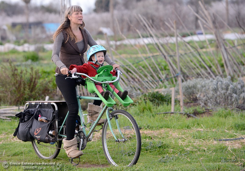 Karisha Longaker and her 1-year-old son Madrone Kee Wednesday, Feb. 11, 2015. GRUB, the longtime intentional community that focuses on farming off of Dayton Road, is at risk of being put off the land it has tended for so long as the owner tries to sell it. They are hoping someone will step forward to buy it who will support their continued use of the property. (Bill Husa -- Enterprise-Record)
