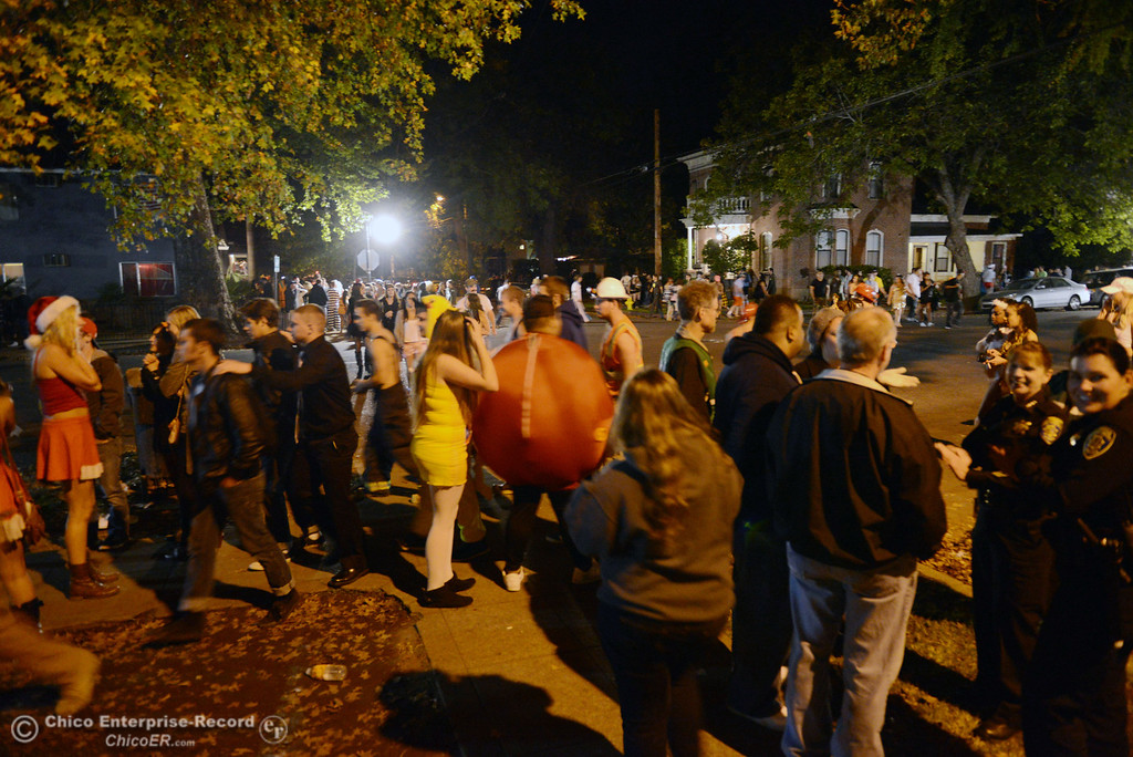 Description of . Costumed crowds walk through the streets of downtown and south Chico State campus area for Halloween Thursday, October 31, 2013 in Chico, Calif.  (Jason Halley/Chico Enterprise-Record)