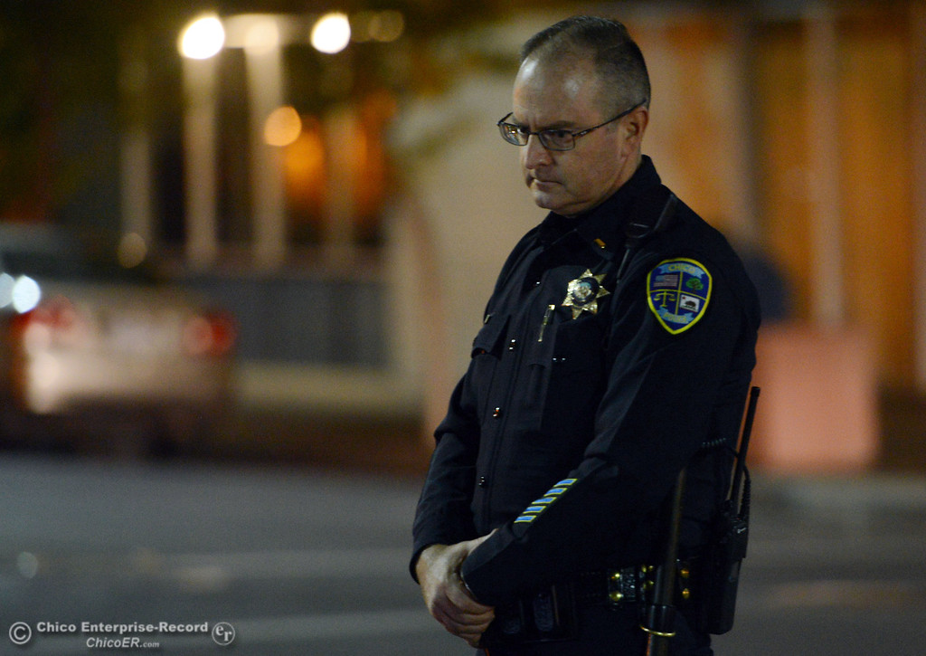 Description of . Chico Police Lt. Mike O'Brien patrols the through the streets of downtown and south Chico State campus area for Halloween Thursday, October 31, 2013 in Chico, Calif.  (Jason Halley/Chico Enterprise-Record)