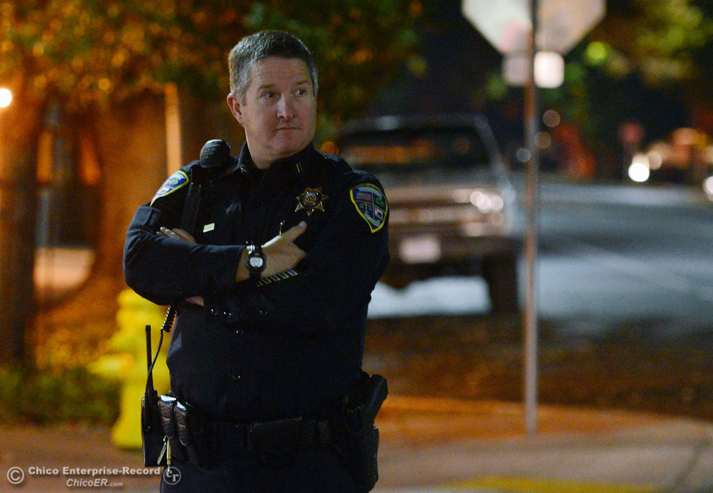 Description of . Chico police Capt. Ford Porter patrols the through the streets of downtown and south Chico State campus area for Halloween Thursday, October 31, 2013 in Chico, Calif.  (Jason Halley/Chico Enterprise-Record)