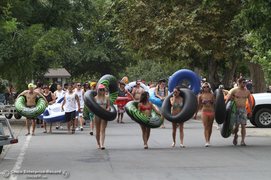 Description of . Floaters prepare to participate in the Labor Day weekend float of the  Sacramento River on Sunday, September 1, 2013. (Frank Rebelo/Staff Photo)
