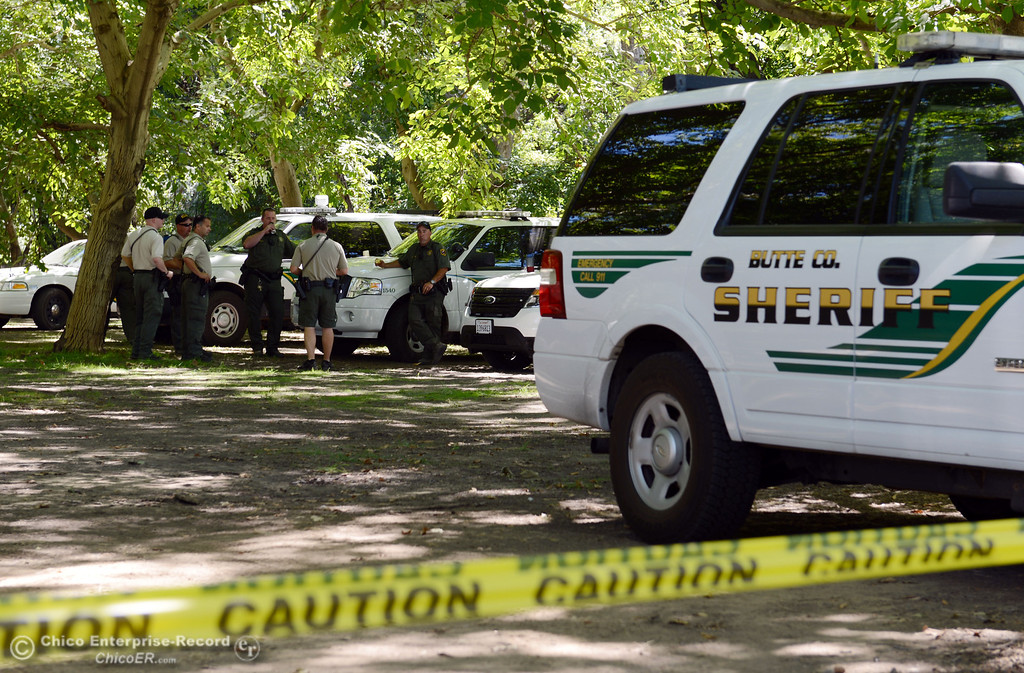 Description of . Butte County Sheriff deputies were available for the very few people that came out to float on the river that enforced an alcohol ban as part of Labor Day weekend Saturday, August 31, 2013 in Hamilton City, Calif.  (Jason Halley/Chico Enterprise-Record)