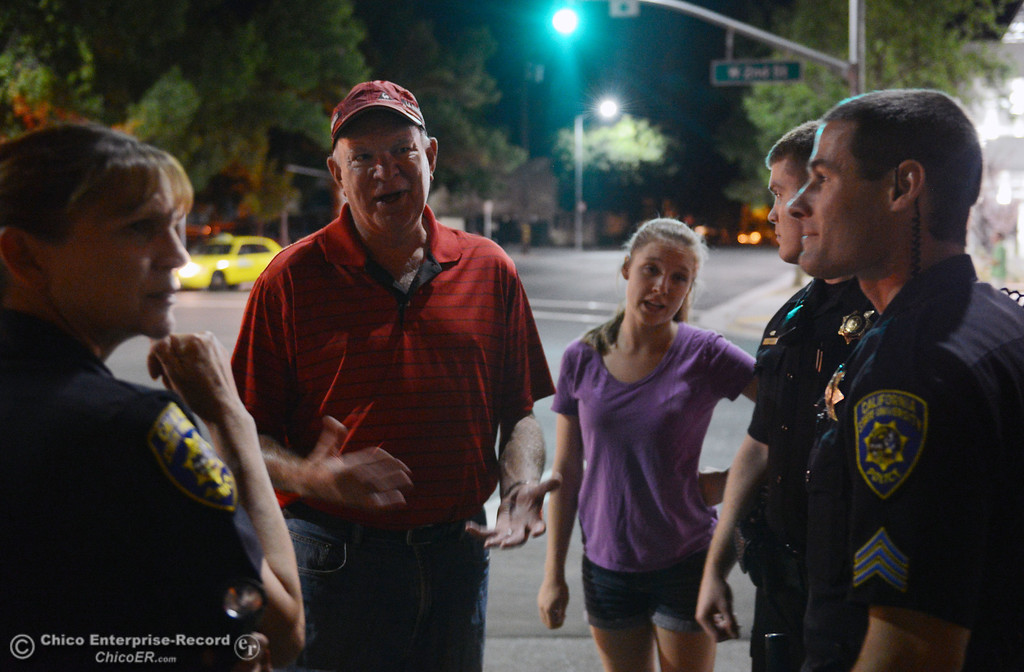 Description of . Chico State President Paul Zingg (left) and Associated Students President Taylor Herren (right) along with University Police officers and other University officials walked around downtown and the south campus neighborhoods on Friday, August 30, 2013 in Chico, Calif.  (Jason Halley/Chico Enterprise-Record)
