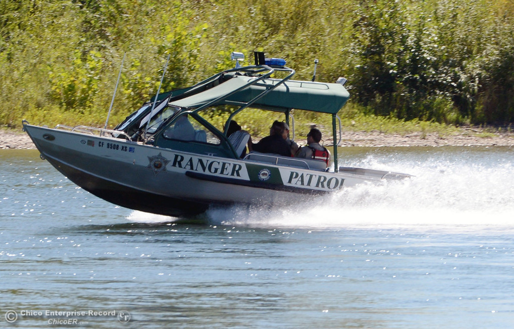 Description of . A California State Parks patrol boat cruises the Sacramento River as there were very few people that came out to float on the river, which authorities were enforcing an alcohol ban as part of Labor Day weekend Saturday, August 31, 2013 in Hamilton City, Calif.  (Jason Halley/Chico Enterprise-Record)