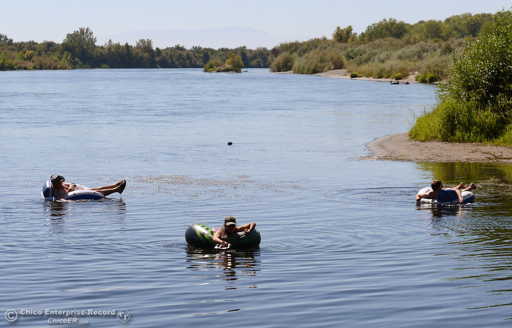 Description of . Antonio Valoerga, 19, from Napa (left), Sacramento State student Mariah Braddock, 19, (center) and University of Oregon student Nathan Bergfelt, 19 (right) were three of the very few amount of people that came out to float on the Sacramento River, which authorities were enforcing an alcohol ban as part of Labor Day weekend Saturday, August 31, 2013 in Hamilton City, Calif.  (Jason Halley/Chico Enterprise-Record)