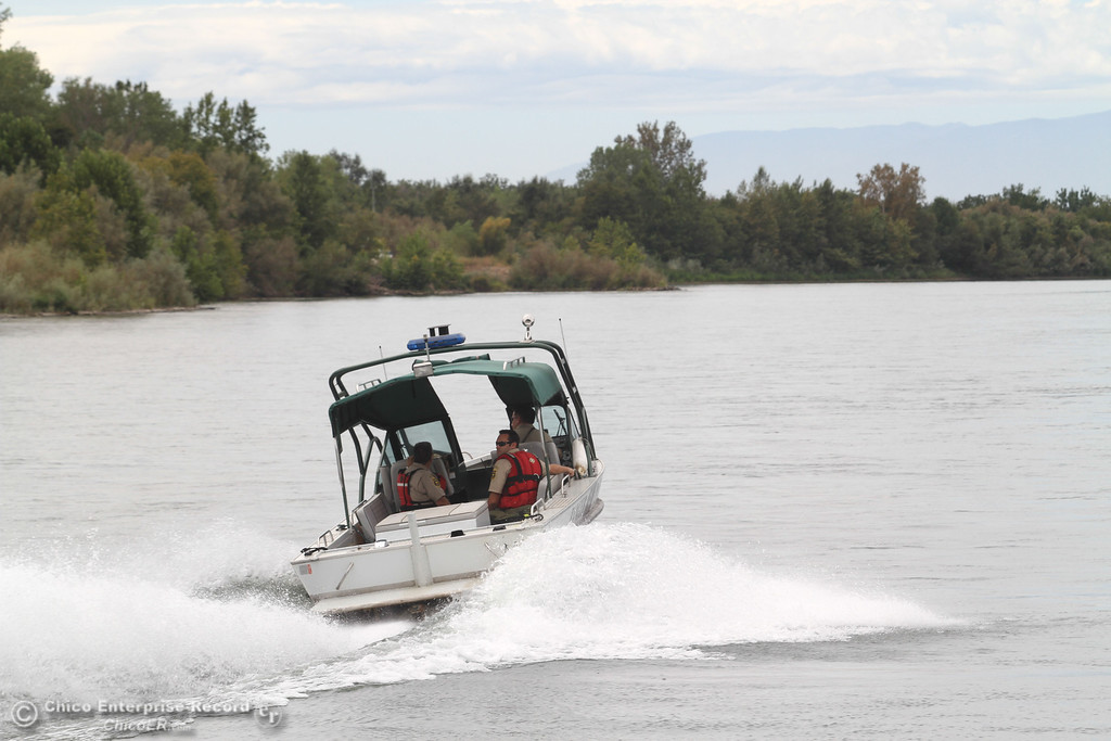 Description of . Butte County Sheriff boat makes its way back up the Sacramento River  on Sunday, September 1, 2013 to patrol and keep floaters safe. (Frank Rebelo/Staff Photo)