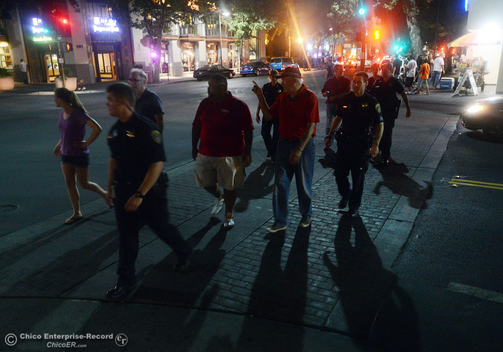 Description of . Chico State President Paul Zingg and other University officials with University Police walked around the south campus neighborhoods on Friday, August 30, 2013 in Chico, Calif.  (Jason Halley/Chico Enterprise-Record)