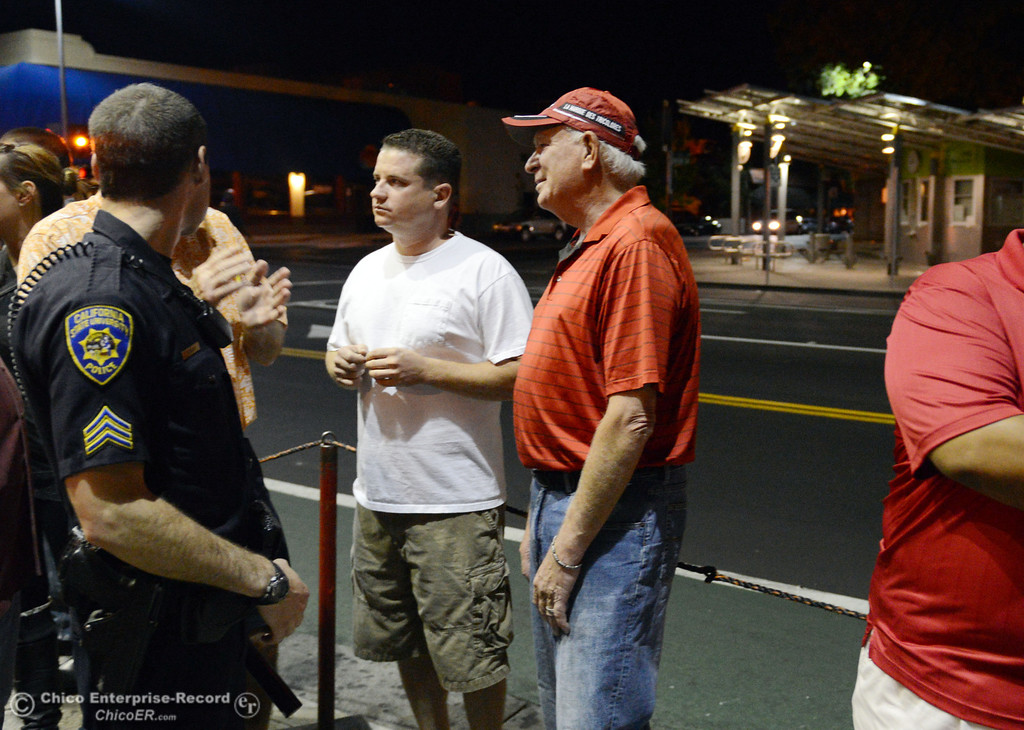 Description of . Chico State President Paul Zingg (center) chats with people in front of the Madison Bear Garden University Police officers and other University officials walked around downtown and the south campus neighborhoods on Friday, August 30, 2013 in Chico, Calif.  (Jason Halley/Chico Enterprise-Record)