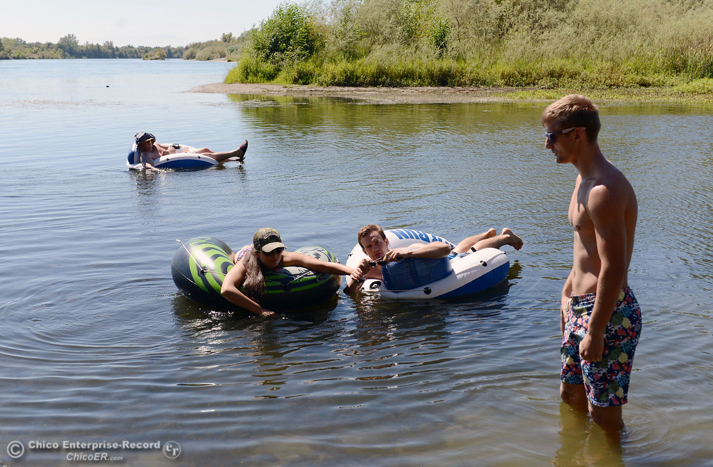 Description of . Antonio Valoerga, 19, from Napa (back), Sacramento State student Mariah Braddock, 19, (left) and University of Oregon student Nathan Bergfelt, 19 (center) and Chico State student Dan Kelham, 20 (right) were four of the very few amount of people that came out to float on the Sacramento River, which authorities were enforcing an alcohol ban as part of Labor Day weekend Saturday, August 31, 2013 in Hamilton City, Calif.  (Jason Halley/Chico Enterprise-Record)