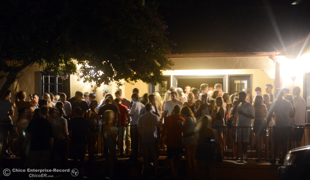 Description of . People party at a house along 4th Street and Hazel Street as the south campus area was fairly quiet before Labor Day weekend starting Friday, August 30, 2013 in Chico, Calif.  (Jason Halley/Chico Enterprise-Record)