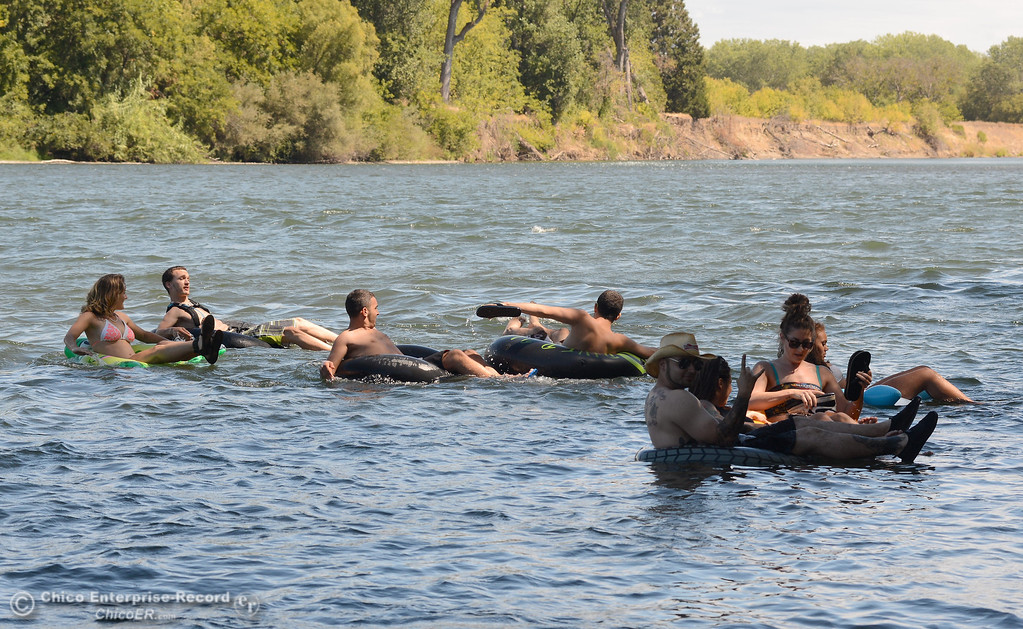 Description of . A handfull of people who wanted to keep up the tradition of floating on the Sacramento River between the Irvine Finch boat Launch and Pine Creek near Scotty's Boat Landing launch their tubes Labor Day Monday, Sept. 2, 2013. (Bill Husa/Staff Photo)