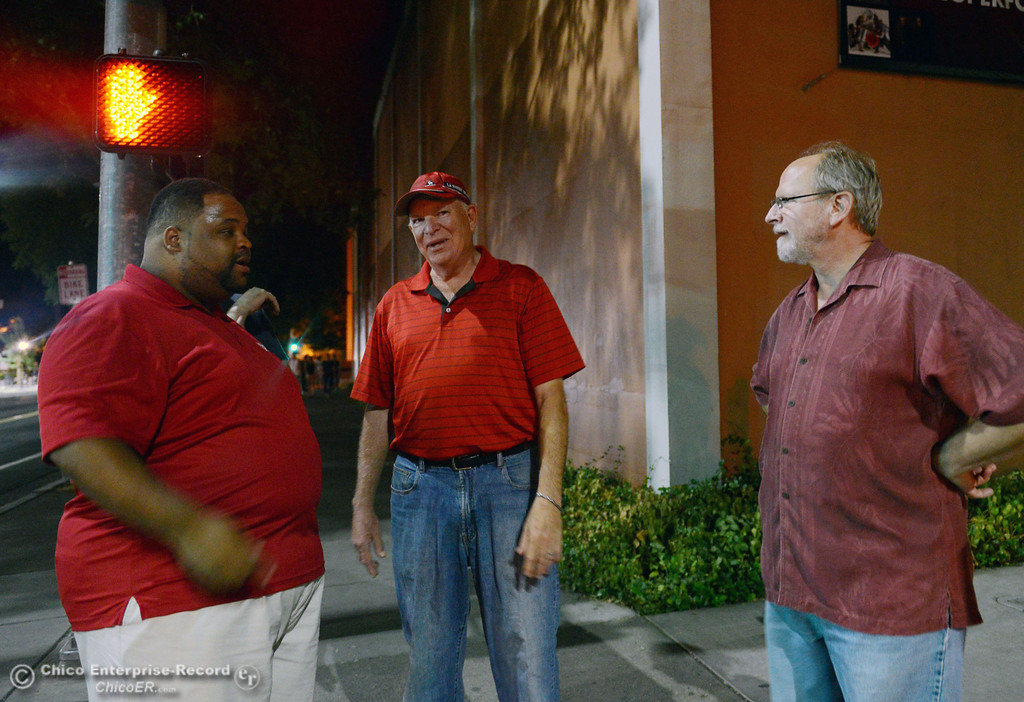 Description of . Chico State Residence Community Coordinator Robert Morton, President Paul Zingg, and VP Student Affairs Drew Calandrella (left to right) along with University Police and other University officials walked around downtown and the south campus neighborhoods on Friday, August 30, 2013 in Chico, Calif.  (Jason Halley/Chico Enterprise-Record)
