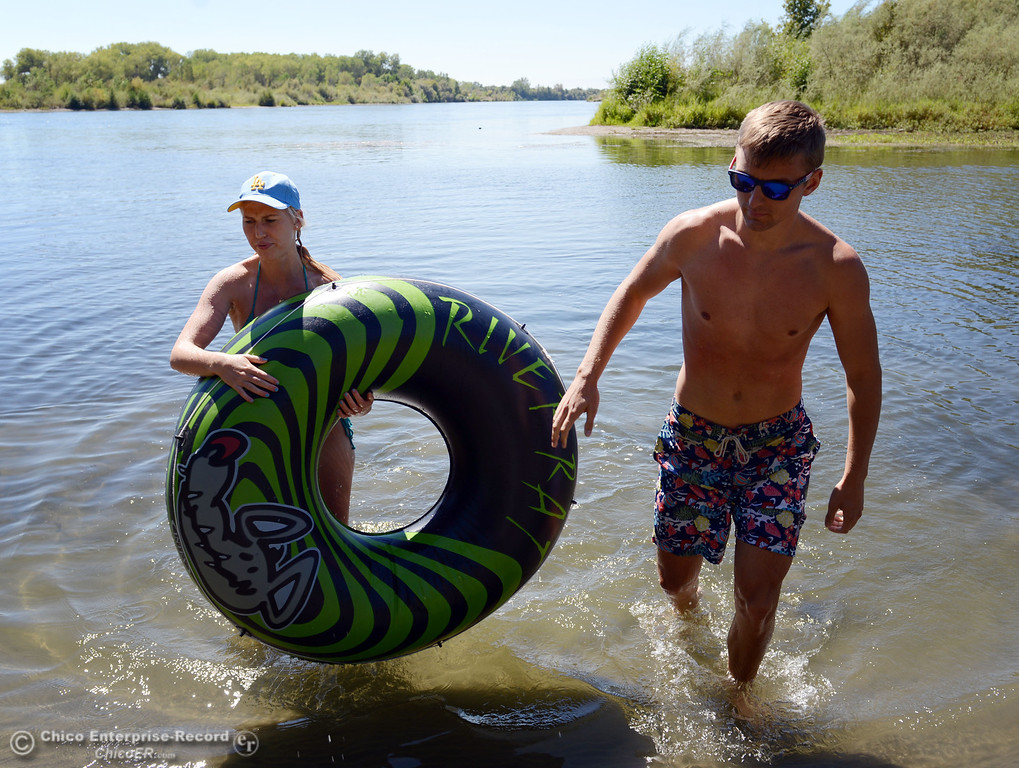 Description of . UCLA student Kelsey Vanderschoot (left) and Chico State student Dan Kelham, 20 (right) were two of the very few amount of people that came out to float on the Sacramento River, which authorities were enforcing an alcohol ban as part of Labor Day weekend Saturday, August 31, 2013 in Hamilton City, Calif.  (Jason Halley/Chico Enterprise-Record)