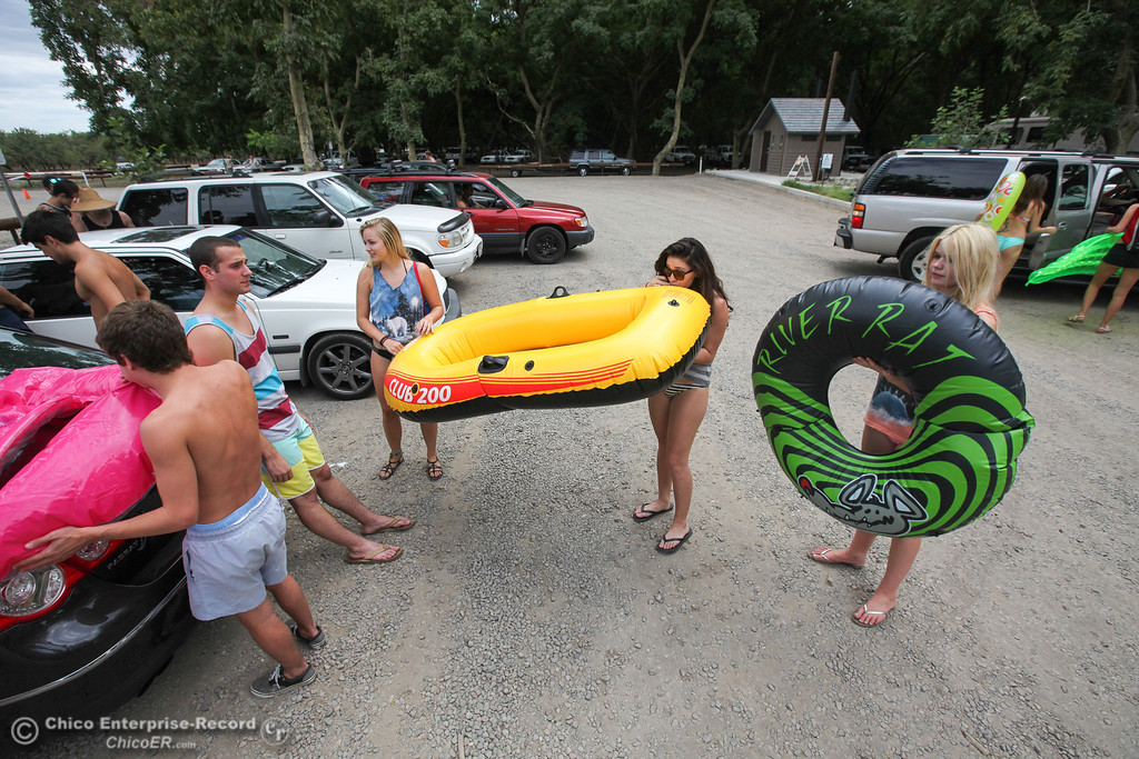Description of . Floaters prepare their tubes for the Labor Day weekend float in the parking lot before heading out on the Sacramento River on Sunday, September 1, 2013. (Frank Rebelo/Staff Photo)