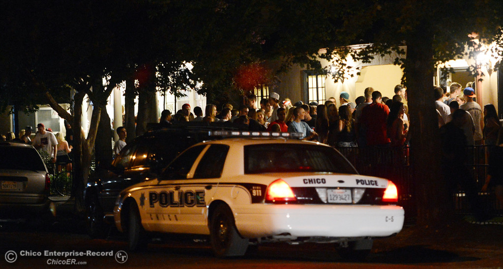 Description of . A Chico police car rests on 4th Street and Hazel Street near a party as the south campus area was fairly quiet before Labor Day weekend starting Friday, August 30, 2013 in Chico, Calif.  (Jason Halley/Chico Enterprise-Record)