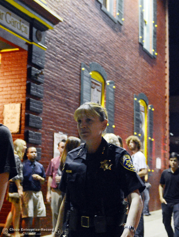 Description of . University Police Chief Robyn Hearne walks in front of the Madison Bear Garden around downtown and the south campus neighborhoods on Friday, August 30, 2013 in Chico, Calif.  (Jason Halley/Chico Enterprise-Record)