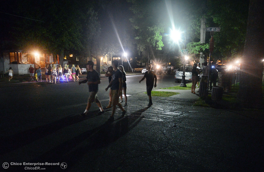 Description of . People walk past 4th Street along Ivy Street in search of a party as the south campus area was fairly quiet before Labor Day weekend starting Friday, August 30, 2013 in Chico, Calif.  (Jason Halley/Chico Enterprise-Record)