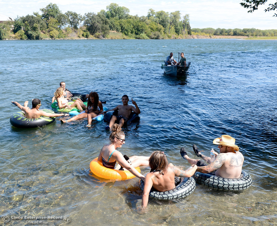 Description of . A handfull of people who wanted to keep up the tradition of floating on the Sacramento River between the Irvine Finch boat Launch and Pine Creek near Scotty\'s Boat Landing launch their tubes Labor Day Monday, Sept. 2, 2013. (Bill Husa/Staff Photo)