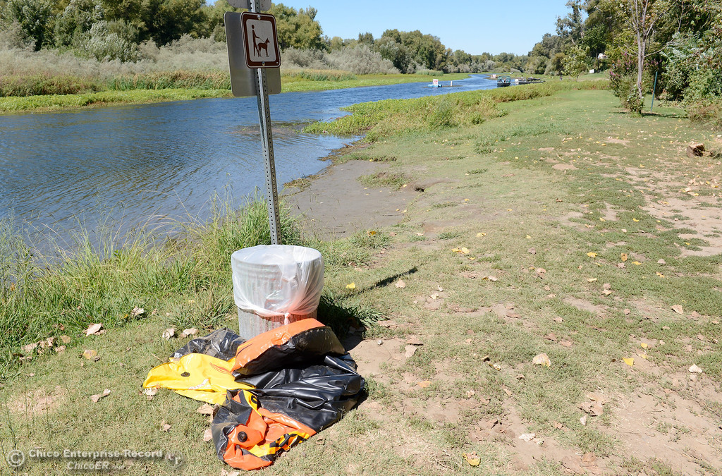 Description of . Less than one garbage can of trash sits on the shore of Pine Creek near Scotty's Boat Landing as the celebration of Labor Day Weekend winds down Monday, Sept. 2, 2013. (Bill Husa/Staff Photo)