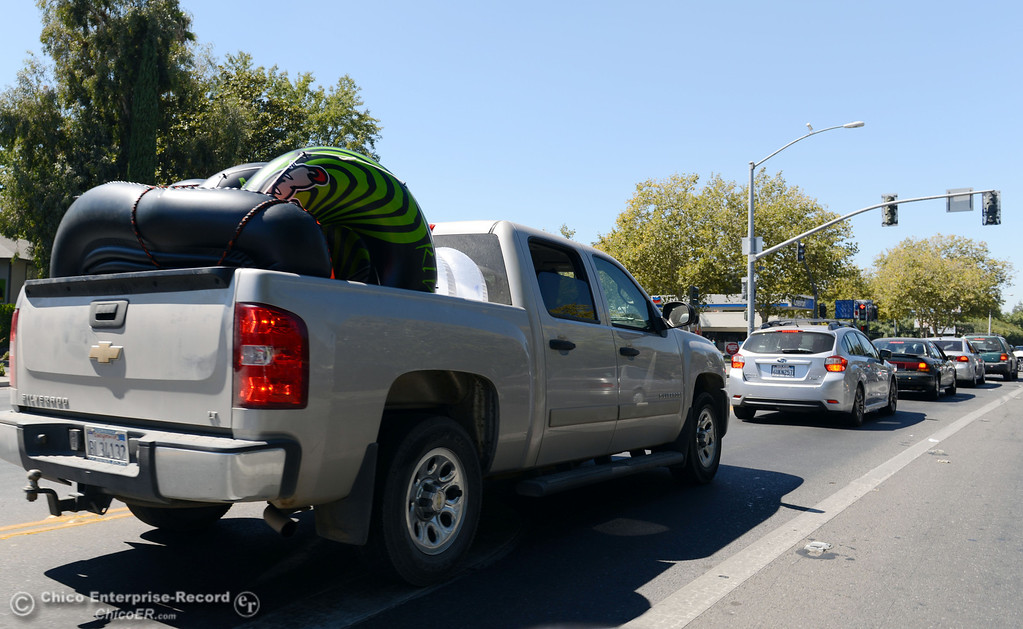 Description of . There were very few people driving with tubes in their vehicles, like this truck along West Sacramento Ave that came out to float on the river that enforced an alcohol ban as part of Labor Day weekend Saturday, August 31, 2013 in Chico, Calif.  (Jason Halley/Chico Enterprise-Record)