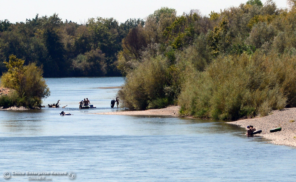 Description of . There were very few people that came out to float on the Sacramento River that enforced an alcohol ban as part of Labor Day weekend Saturday, August 31, 2013 in Hamilton City, Calif.  (Jason Halley/Chico Enterprise-Record)