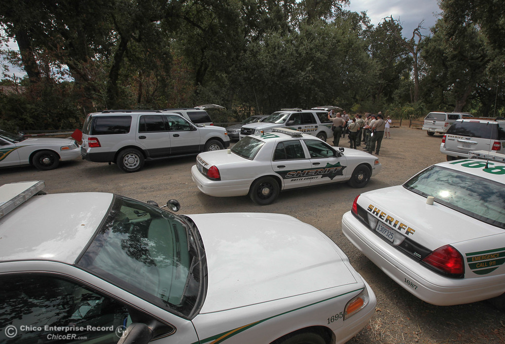Description of . Members of Butte County Sheriff\'s Department attend a briefing before heading out to parts of the Sacramento River for the Labor Day weekend float on Sunday, September 1, 2013. (Frank Rebelo/Staff Photo)