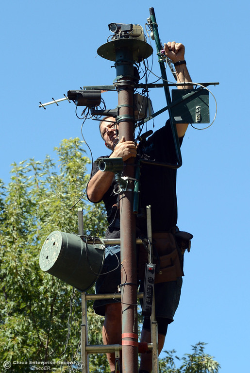 Description of . John Scott sets up live cameras to show river conditions that he is broadcasting inside Scotty\'s Landing as there were very few people that came out to float on the river, which authorities enforced an alcohol ban as part of Labor Day weekend Saturday, August 31, 2013 in Hamilton City, Calif.  (Jason Halley/Chico Enterprise-Record)