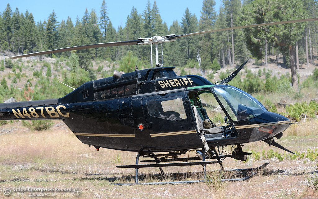 Description of . The Butte County Sheriff's helicopter is used to eradicate nearly 7,300 marijuana plants from a remote area in Upper Concow Thursday, Aug. 15, 2013. Two suspects were arrested in the marijuana garden. (Bill Husa/Staff Photo)