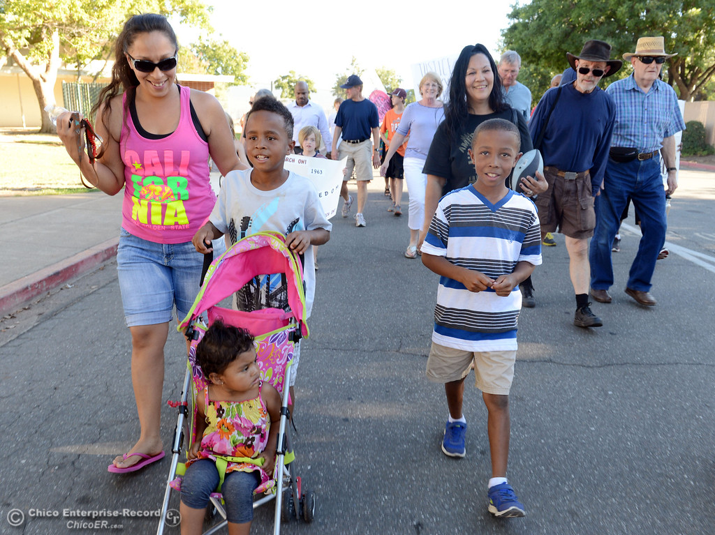 . Visilla Fairbanks (left), Savaun Fairbanks, 7 (center), Kivonte Fairbanks, 8 (right) Syntell Fairbanks, 2 (bottom), and Kristina Fairbanks (back) walk with the community that came out to remember the 50th Anniversary of the Martin Luther King Jr. March on Washington by marching from the Dorothy Johnson Center to Community Park on Wednesday, August 28, 2013 in Chico, Calif.  (Jason Halley/Chico Enterprise-Record)