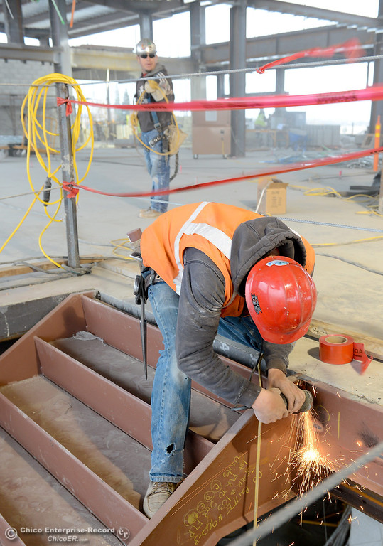 Description of . Juan Rosas uses a grinder on an area by a stairwell during construction of the new North Butte County Courthouse located off of Bruce Road at 1701 Concord Ave. in Chico, Calif. Wednesday Jan. 29, 2014.  (Bill Husa/Staff Photo)