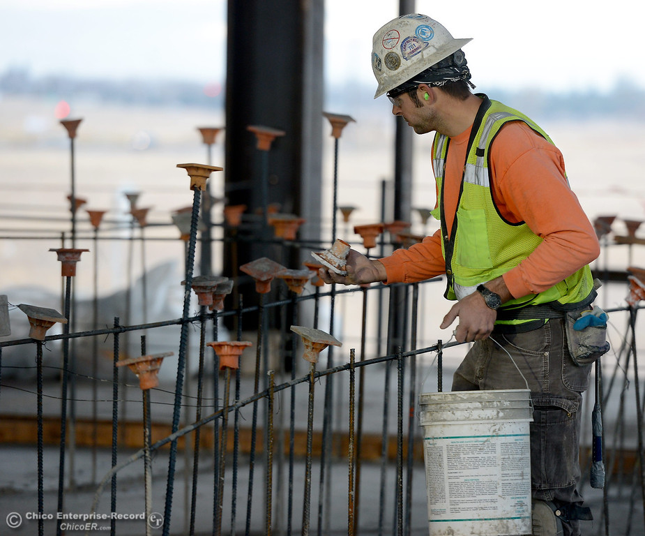 Description of . A worker puts caps on exposed rebar for safety during construction of the new North Butte County Courthouse located off of Bruce Road at 1701 Concord Ave. in Chico, Calif. Wednesday Jan. 29, 2014.  (Bill Husa/Staff Photo)