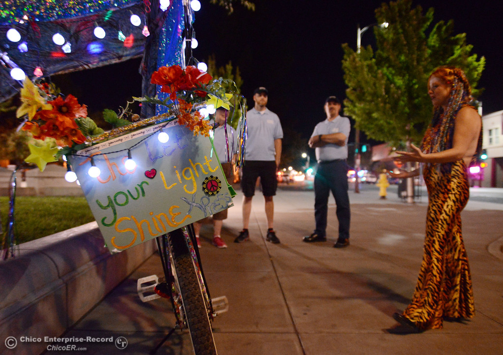 Description of . Kelly Mosenfelder created a colorful light bike for burning man that she test rode around downtown as she talks with people that were part of the Street Pastors program Friday, August 23, 2013 in Chico, Calif.  (Jason Halley/Chico Enterprise-Record)