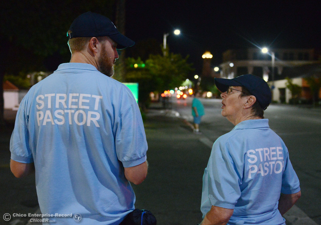 Description of . Jeremy Rhodes and Nancy Calkins (left to right) walked around downtown Chico with others that were part of the Street Pastors program Friday, August 23, 2013 in Chico, Calif.  (Jason Halley/Chico Enterprise-Record)