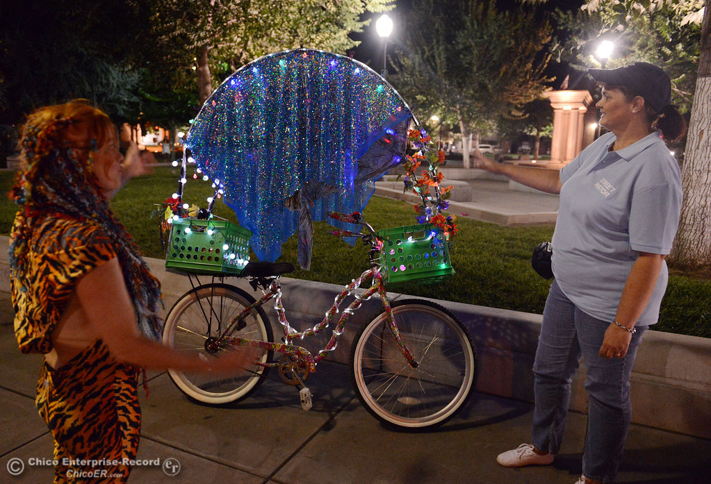 Description of . Kelly Mosenfelder created a colorful light bike for burning man that she test rode around downtown as she talks with Judy Clark, that was part of the Street Pastors program Friday, August 23, 2013 in Chico, Calif.  (Jason Halley/Chico Enterprise-Record)